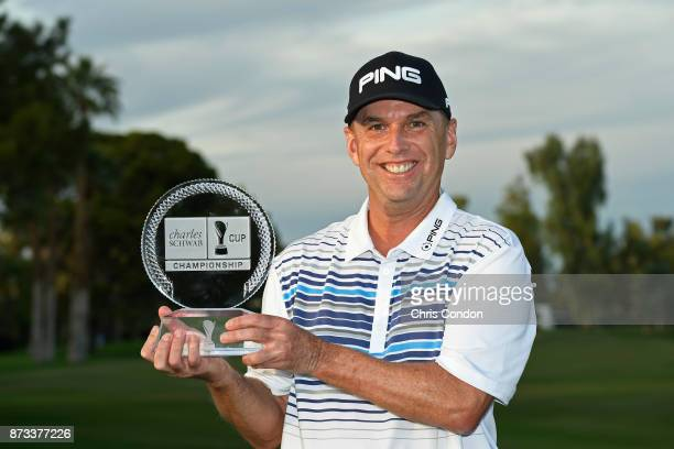 Kevin Sutherland holds the tournament trophy after winning the PGA TOUR Champions Charles Schwab Cup Championship at Phoenix Country Club on November...