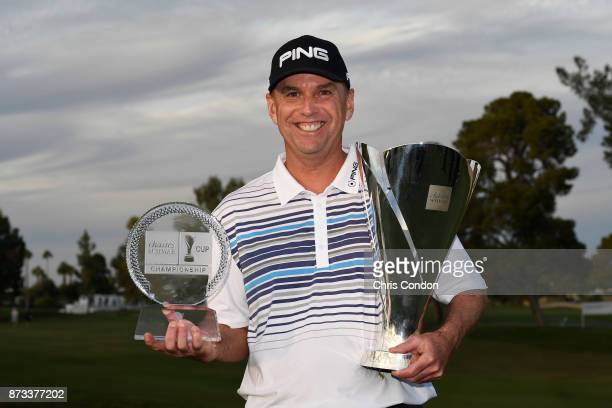 Kevin Sutherland holds the tournament trophy and the Charles Schwab Cup after winning the PGA TOUR Champions Charles Schwab Cup Championship at...