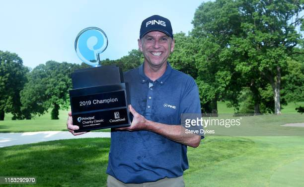 Kevin Sutherland holds the trophy after winning the Principal Charity Classic at the Wakonda Club on June 02 2019 in Des Moines Iowa