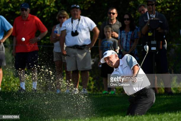 Kevin Sutherland plays from a bunker on the 14th hole during the final round of the PGA TOUR Champions DICK'S Sporting Goods Open at EnJoie Golf...