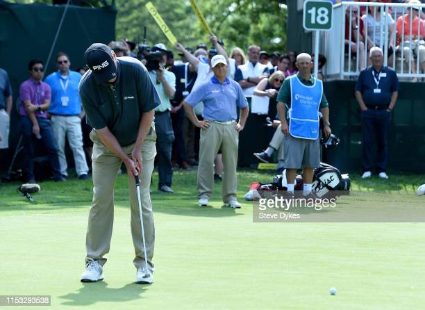 Kevin Sutherland sinks his putt to win the tournament as Scott Parel looks on during the final round of the Principal Charity Classic at the Wakonda...