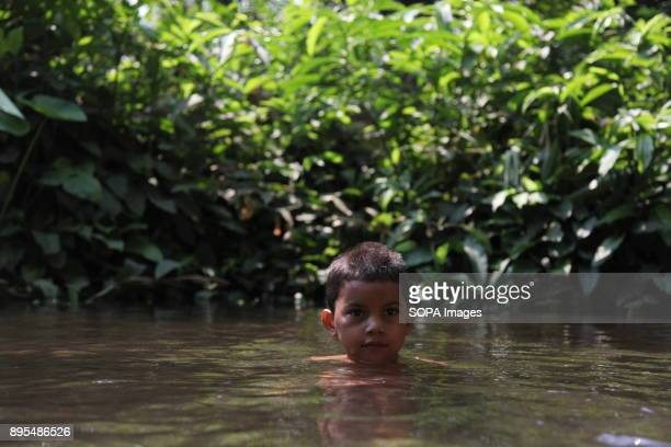 CHICHIGALPA CHINANDEGA NICARAGUA Kevin swimming in a waterhole on the outskirts of Chichigalpa He used to come here with his father and two eldest...