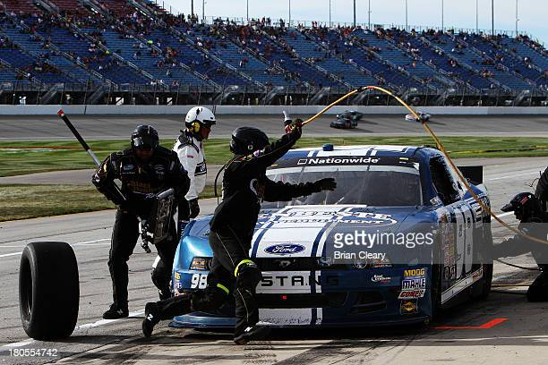 Kevin Swindell driver of the Carroll Shelby Engine Co Ford makes a pit stop during the NASCAR Nationwide Series Dollar General 300 Powered by...