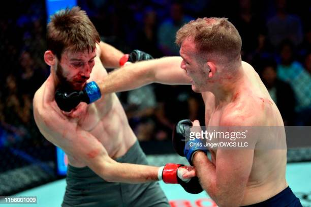 Kevin Syler of Bolivia punches Lance Lawrence in their featherweight bout during Dana White's Contender Series at the UFC Apex on July 16 2019 in Las...