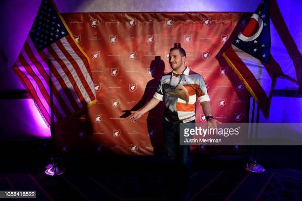 Kevin T Livingston of Columbus poses for a photo for his friends at the Ohio Republican Party's election night party at the Sheraton Capitol Square...