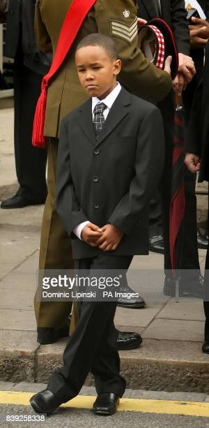 Kevin the son of Lance Sergeant Dale McCallum of 1st Battalion Scots Guards looks on after the funeral of his father at the New Testament Church of...