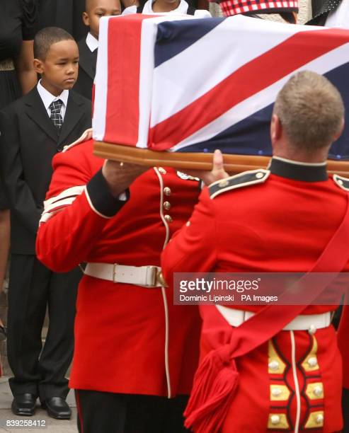 CROP Kevin the son of Lance Sergeant Dale McCallum of 1st Battalion Scots Guards watches as pallbearers carry his fathers coffin out of the New...
