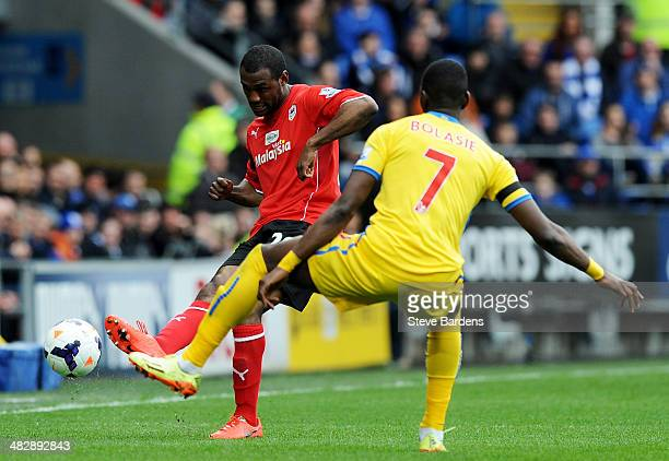 Kevin Theophile Catherine of Cardiff plays the ball past Yannick Bolasie of Crystal Palace during the Barclays Premier League match between Cardiff...