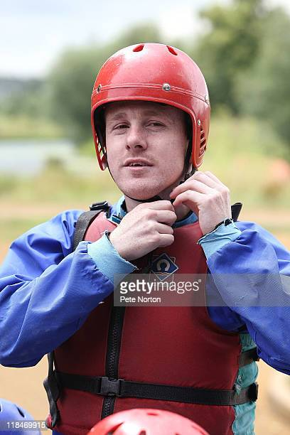 Kevin Thornton of Northampton Town adjusts his crash helmet during a training session at Nene Whitwater Centre on July 7 2011 in Northampton England