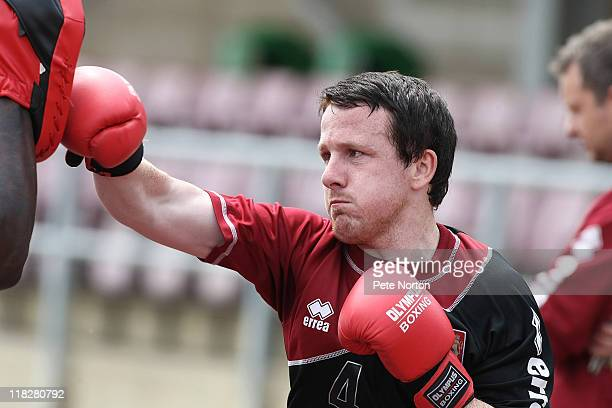 Kevin Thornton of Northampton Town wears boxing gloves during a training session at Sixfields Stadium on July 4, 2011 in Northampton, England.