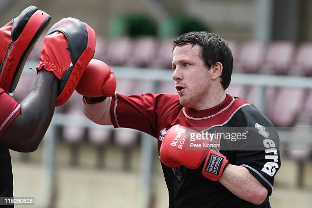 Kevin Thornton of Northampton Town wears boxing gloves during a training session at Sixfields Stadium on July 4 2011 in Northampton England