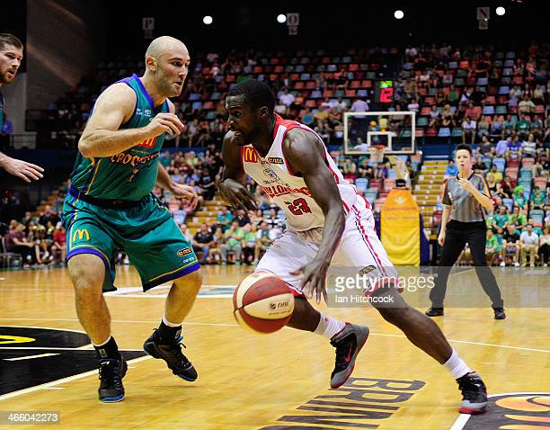 Kevin Tiggs of the Hawks looks to drive past Steven Markovic of the Crocodiles during the round 16 NBL match between the Townsville Crocodiles and...