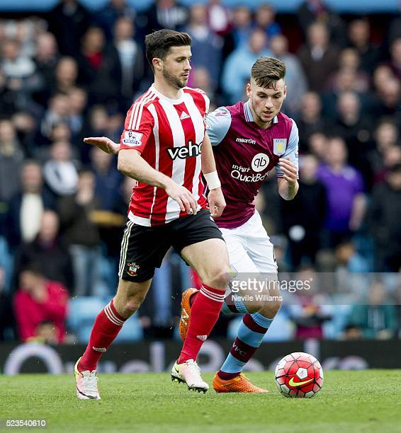 Kevin Toner of Aston Villa is challenged by Shane Long of Southampton during the Barclays Premier League match between Aston Villa v Southampton at...