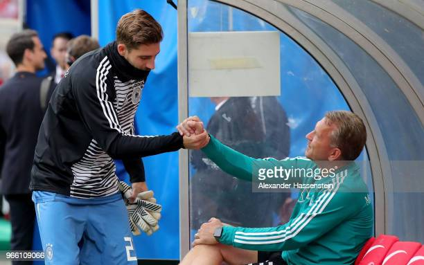 Kevin Trapp goalkeeper of Germany shake hands with goalkeeper coach Andreas Koepke before the International Friendly match between Austria and...
