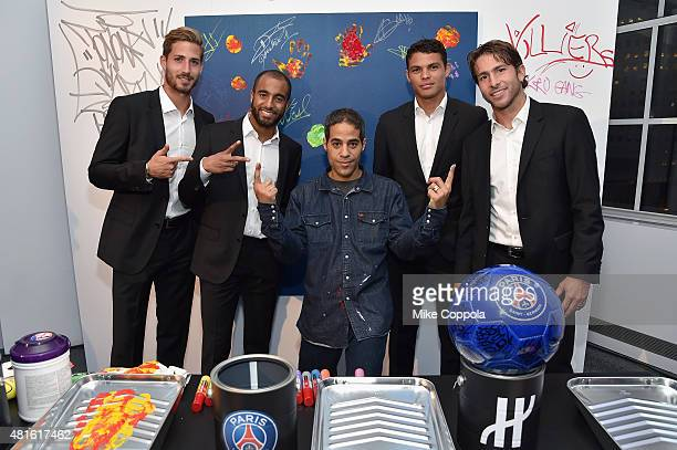 Kevin Trapp Lucas Moura JonOne Thiago Silva and Maxwell attend the launch of Hublot's latest timepiece with Paris SaintGermain Team and celebrates...