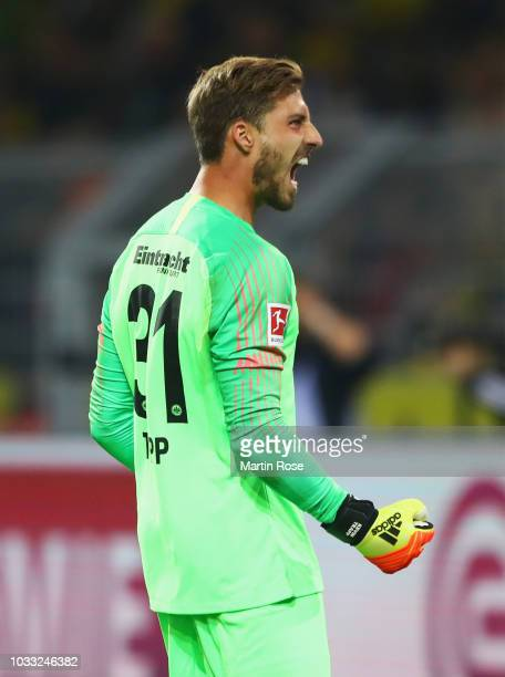 Kevin Trapp of Eintracht Frankfurt celebrates as Sebastien Haller of Eintracht Frankfurt scores team's first goal during the Bundesliga match between...