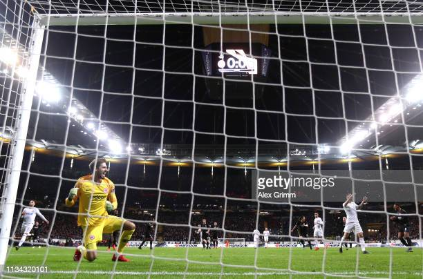 Kevin Trapp of Eintracht Frankfurt celebrates saves Marcelo Brozovic of FC Internazionale penalty during the UEFA Europa League Round of 16 First Leg...