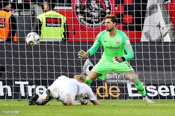 Kevin Trapp of Eintracht Frankfurt looks on as teammate Martin Hinteregger scores an own goal the sixth goal for Bayer 04 Leverkusen during the...