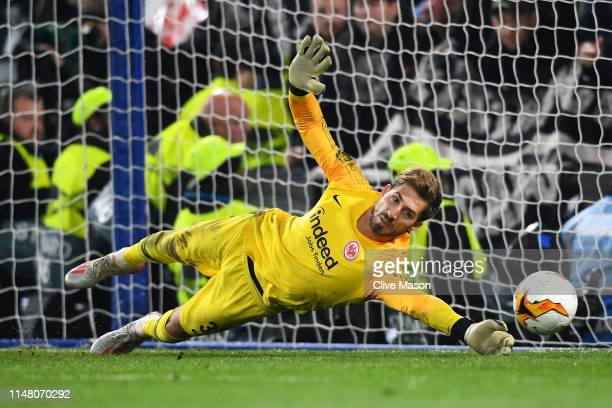 Kevin Trapp of Eintracht Frankfurt saves a penalty from Cesar Azpilicueta of Chelsea in the penalty shoot out during the UEFA Europa League Semi...