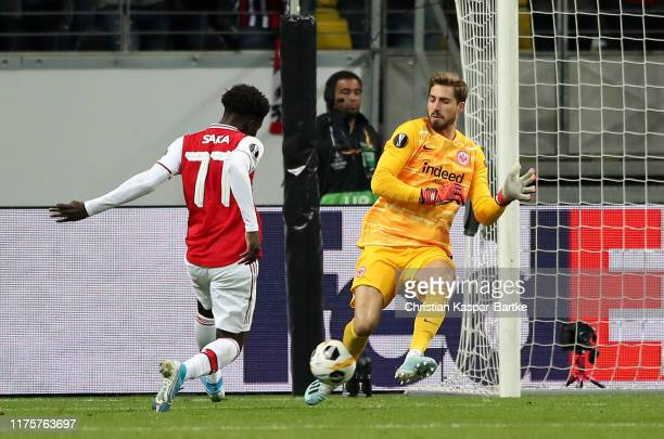 Kevin Trapp of Eintracht Frankfurt saves Bukayo Saka of Arsenal shot at goal during the UEFA Europa League group F match between Eintracht Frankfurt...