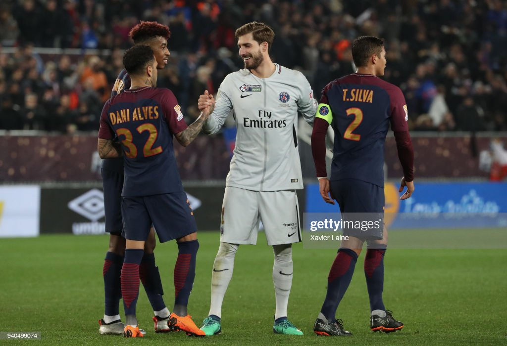 Kevin Trapp of Paris Saint-Germain celebrate the victory with Dani Alves and Thiago Silva during the League Cup Final match between Paris Saint-Germain (PSG) and AS Monaco at Matmut Arena on March 31, 2018 in Bordeaux France.