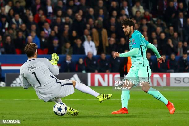 Kevin Trapp of Paris SaintGermain saves a shot on goal from Andre Gomes of Barcelona during the UEFA Champions League Round of 16 first leg match...