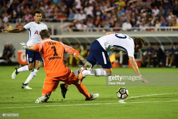 Kevin Trapp of PSG receives a red card from referee Ted Unkel for denying Harry Kane of Spurs a clear goal scoring opportunity during the...