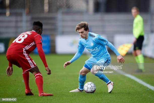 Kevin Tshiembe of Lyngby BK and Saba Lobzhanidze of Randers FC in action during the Danish Alka Superliga match between Randers FC and Lyngby BK at...