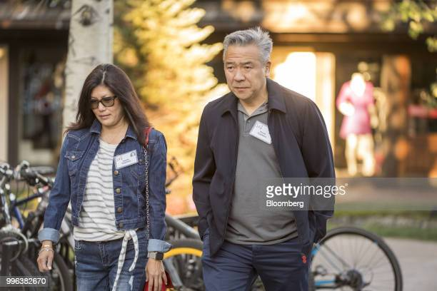 Kevin Tsujihara chairman and chief executive officer of Warner Bros Entertainment Inc right and Sandy Tsujihara arrive for a morning session of the...