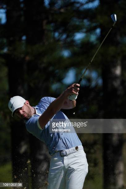 Kevin Tway of the United States hits a tee shot on the 2nd hole during the final round of the Sentry Tournament of Champions at the Plantation Course...