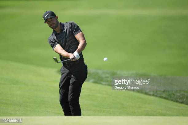 Kevin Tway of the United States plays a shot on the 17th hole during the first round of The Northern Trust on August 23 2018 at the Ridgewood...