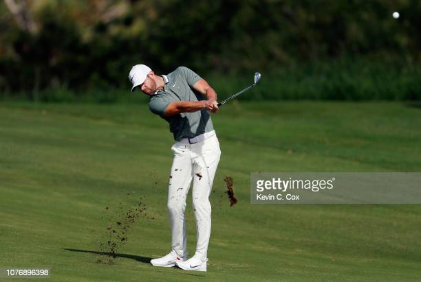 Kevin Tway of the United States plays a shot on the fourth hole during the first round of the Sentry Tournament of Champions at the Plantation Course...