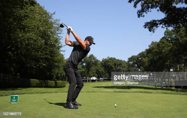 Kevin Tway of the United States plays his shot from the 18th tee during the first round of The Northern Trust on August 23 2018 at the Ridgewood...