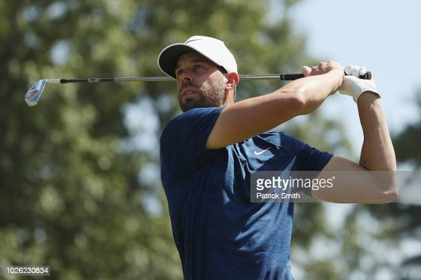 Kevin Tway of the United States plays his shot from the tenth tee during round three of the Dell Technologies Championship at TPC Boston on September...
