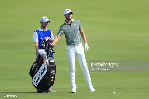 Kevin Tway of the United States pulls a club from his bag as he prepares to play a shot on the 18th hole during the first round of the Sentry...