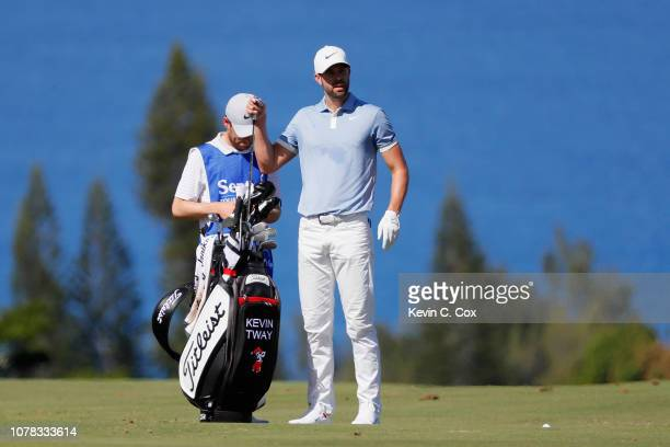Kevin Tway of the United States pulls a club from his bag as he prepares to play a shot on the fourth hole during the final round of the Sentry...