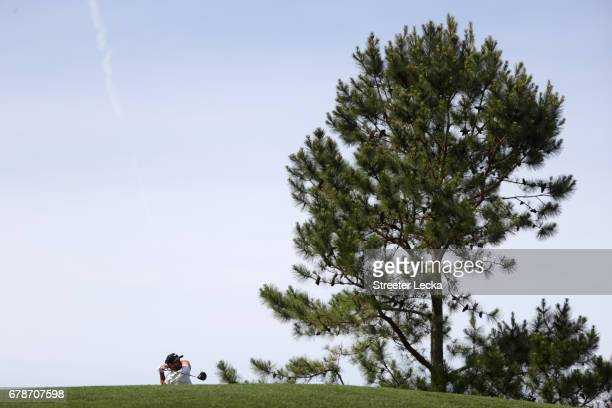 Kevin Tway plays a shot on the 18th hole during round one of the Wells Fargo Championship at Eagle Point Golf Club on May 4 2017 in Wilmington North...
