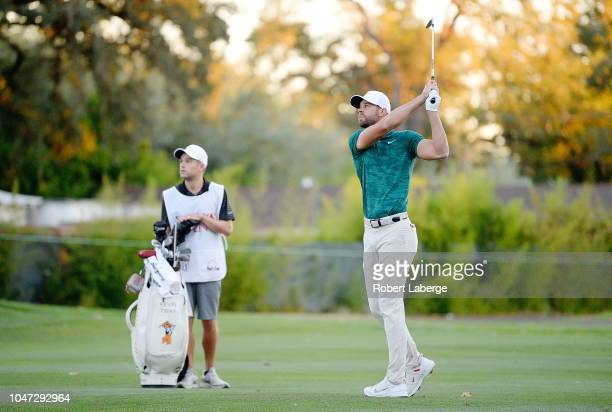Kevin Tway plays his shot on a third hole sudden death playoff against Ryan Moore on the 10th fairway during the final round of the Safeway Open at...