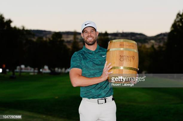 Kevin Tway poses with the trophy after putting in to win on a third hole sudden death playoff against Ryan Moore during the final round of the...