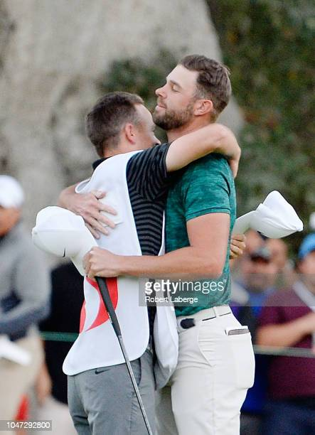 Kevin Tway reacts with his caddie Marc Sambol after putting in to win on a third hole sudden death playoff against Ryan Moore on the 10th green...