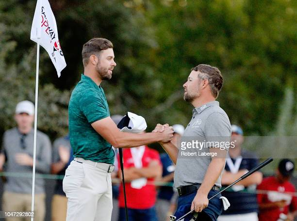 Kevin Tway shakes hands with Ryan Moore after putting in to win on a third hole sudden death playoff on the 10th green during the final round of the...