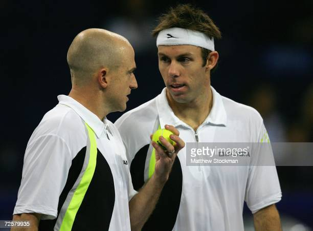 Kevin Ullyett of Zimbabwe and Paul Hanley of Australia confer between points against Bob and Mike Bryan of the United States during the round robin...