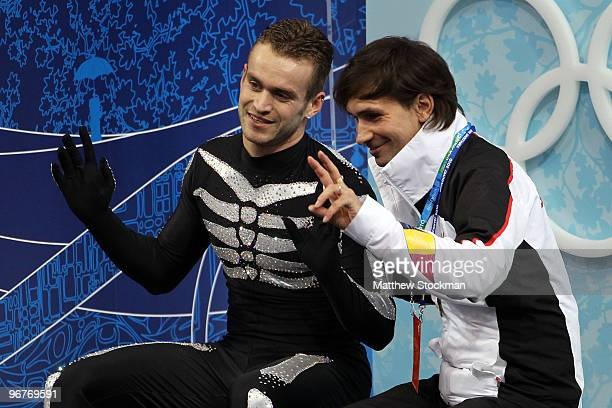 Kevin van der Perren of Belgium reacts after his routine in the men's figure skating short program on day 5 of the Vancouver 2010 Winter Olympics at...