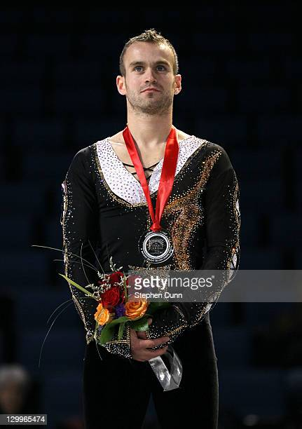 Kevin Van Der Perren of Belgium stands with his silver medal after the men's competition during Hilton HHonors Skate America at Citizens Business...