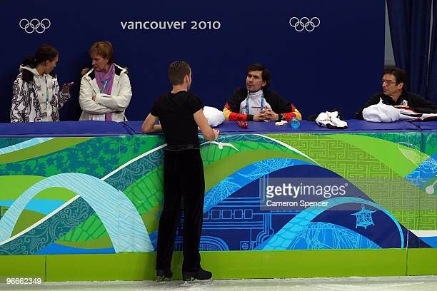 Kevin van der Perren of Belgium talks to his coach during figure skating training on day 2 of the Vancouver 2010 Winter Olympics at Pacific Coliseum...
