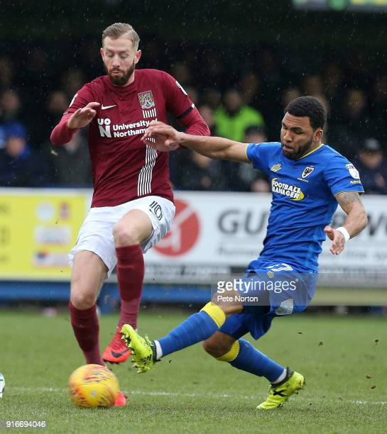 Kevin van Veen of Northampton Town contests the ball with Andy Barcham of AFC Wimbledon during the Sky Bet League One match between AFC Wimbledon and...
