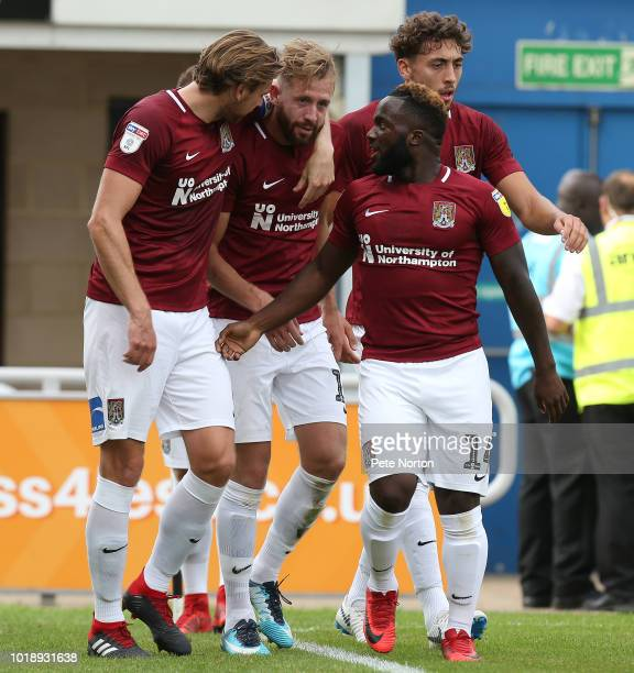 Kevin van Veen of Northampton Town Town is congratulated by team mates Matt Crooks Ash Taylor and Junior Morias after scoring his sides second goal...