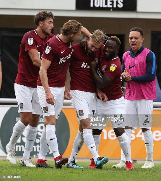 Kevin van Veen of Northampton Town Town is congratulated by team amtes Matt Crooks Ash TaylorJunior Morias and Shay Facey after scoring his sides...