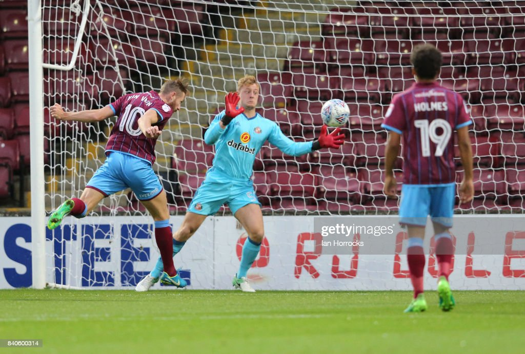 Kevin Van Veen of Scunthorpe (L) scores the opening goal during the Checkertrade Trophy group stage match at Glanford Park on August 29, 2017 in Scunthorpe, England.