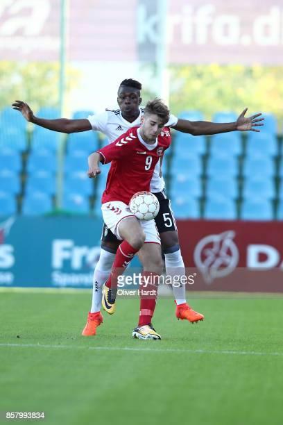Kevin Vangu Phambu Bukusu of Germany and Muamer Brajanac of Denmark compete for the ball during the Mens U17 international friendly match between...